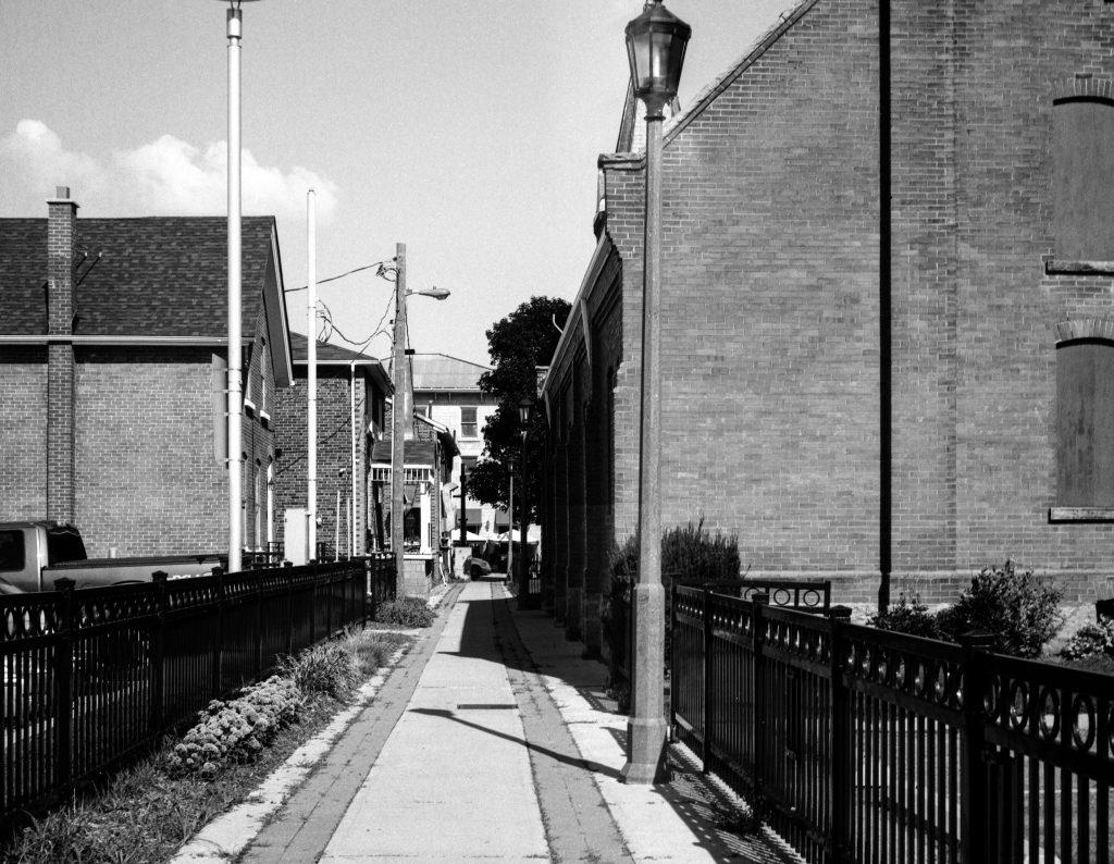 A sidewalk between two buildings