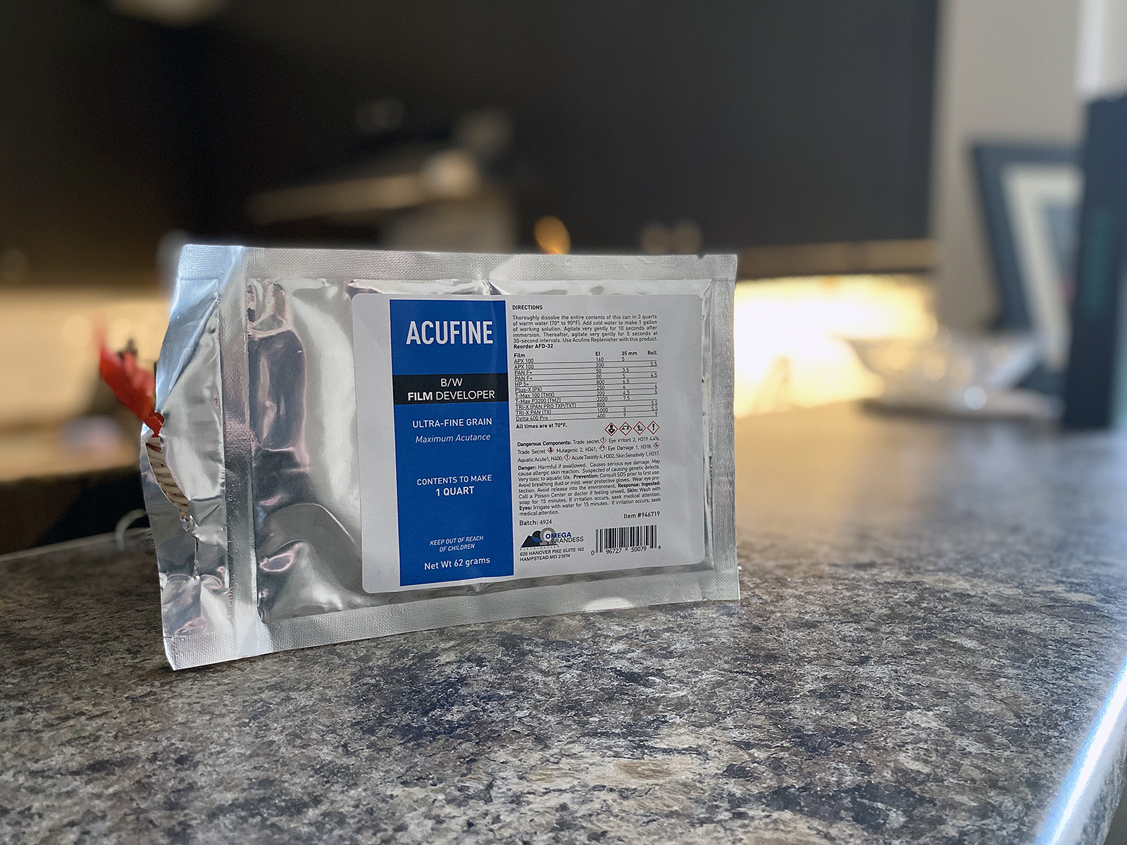 Silver Foil Pouch with Blue and White Label stating it contains the powder to make Acufine developer.