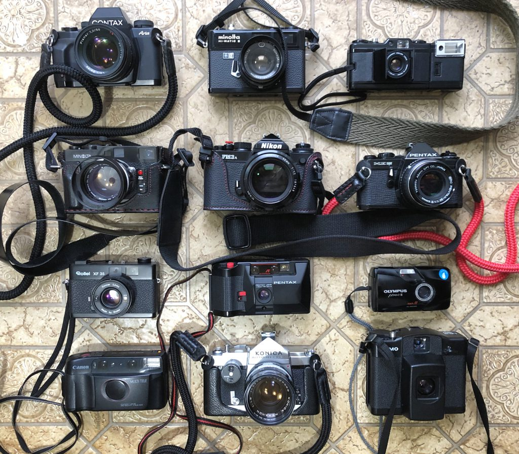 several film cameras arranged in a grid.